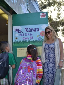 Nikki Kanan greets arriving second graders at Brentwood Elementary Science Magnet in Los Angeles.