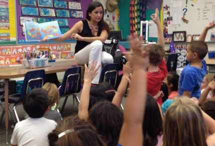 Alicia Hinde reading to her second graders and asking about ways to count and group the fish on the page.