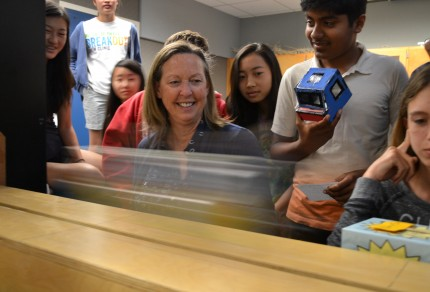 """Kathy Marvin's 8th graders experiment with inertia and  momentum, launching a cardboard """"car"""" towards a wall."""