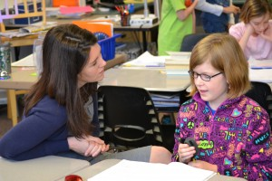 Sarah Kirby-Gonzalez works with a student at Mather Heights Elementary School.
